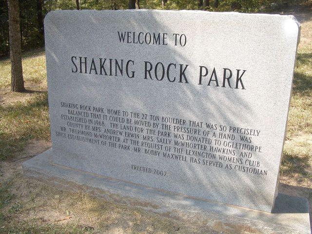 1280px-Shakingrocksign